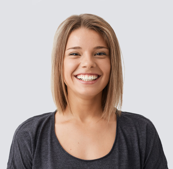 Woman in a grey top smiling