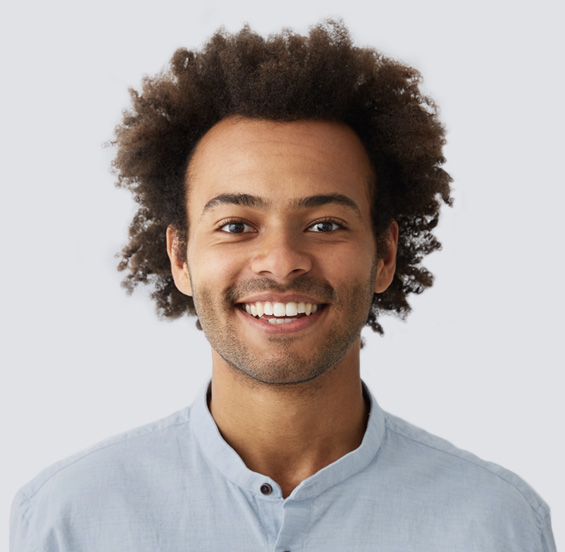 Man smiling in a light blue shirt